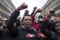 People protest against police violence in Paris in Sunday at Place de la Republique,. Photo: AP