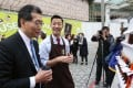 Managing director of Pat Chun Trevor Ng Shen-kuan, explains to Secretary for Commerce and Economic Development Gregory So Kam-leung (left) his food truck business in Tsim Sha Tsui. Photo: Xiaomei Chen