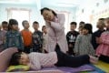 A doctor gives pupils at a kindergarten in Handan, Hebei Province, advice on healthy sleeping body positions on World Sleep Day last year. Photo: Xinhua