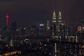 A general view shows Malaysia's Petronas Twin Towers (back R) and the Kuala Lumpur Tower (back L) at night in Kuala Lumpur.Photo: MOHD RASFAN/AFP