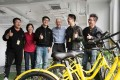 Apple chief executive Tim Cook (centre) during his visit on Tuesday to the offices of bike-sharing start-up Ofo in Beijing. - Photo: SCMP Handout