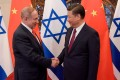 Chinese President Xi Jinping and Israeli Prime Minister Benjamin Netanyahu shake hands ahead of their talks at Diaoyutai State Guesthouse in Beijing on Tuesday. Photo: Reuters