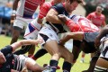 Jamie Hood (left) and Ryan Meacheam battle it out for Hong Kong at the Borneo Sevens. Photos: HKRU