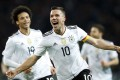 Lukas Podolski grabbed the winner in his final appearance for Germany. Photo: EPA