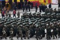 Paramilitary police gather outside the Helong stadium ahead of the World Cup football qualifying match between China and South Korea in Changsha, Hunan province, on Thursday. Photo: AFP