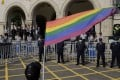 A supporter of same-sex marriage waves a rainbow flag outside the Judicial Yuan in Taipei on Friday. Photo: AFP