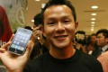 Ho Kak-yin was the first person in Hong Kong to buy the then-state-of-the-art iPhone 3G when it went on sale at Ocean Terminal, Tsim Sha Tsui, on July 11, 2008. Photo: SCMP