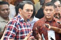 Jakarta's Christian governor Basuki Tjahaja Purnama talks to the media after he casts his vote in Jakarta on February 15. Purnama was put on trial for blasphemy after a doctored video of a speech went viral online. Photo: AFP