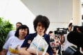 Singapore teenage blogger Amos Yee with his mother Mary Toh Ai Buay and father Alphonsus Yee, outside the state court in Singapore on July 6, 2015. Photo: AFP