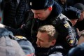 Police officers detain anti-corruption campaigner and opposition figure Alexei Navalny during a rally in Moscow. Photo: Reuters