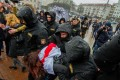 Police officers detain a protester during a rally marking the unofficial Freedom Day in Minsk. Photo: EPA