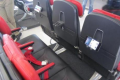 New, slim seats with device friendly features may be the next big thing at AirAsia. Photo: Boonsong Kositchotethana