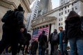 A file picture of pedestrians in Wall Street in front of the New York Stock Exchange . Photo: Bloomberg