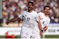 Iran's Mehdi Taremi (front) celebrates after scoring against China in their World Cup qualifying game. Photo: Xinhua