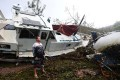 Bradley Mitchell inspects the wreckage of yachts washed ashore by Cyclone Debbie at Shute Harbour near Airlie Beach in northern Australia on Wednesday. Photo: EPA