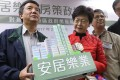 """Then chief executive hopeful Carrie Lam with Wong Kwun (left), chairman of the Federation of Public Housing Estates, in Kwun Tong on February 18. In her election platform, Lam pledged to improve access to housing, including for first-time homebuyers in the """"sandwich class"""" who are ineligible for public housing. Photo: Edward Wong"""
