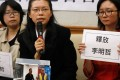 Li Ching-yu (centre), the wife of Li Ming-che (seen in smaller photo), speaks at a press conference in Taipei on Wednesday. Photo: Reuters