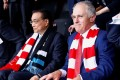 Australia's Prime Minister Malcolm Turnbull and Chinese Premier Li Keqiang watch an Australian Football League game at the Sydney Cricket Ground in Australia on Saturday. Photo: Reuters
