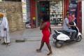 An African woman walks through one of the few New Delhi neighbourhoods where Africans can rent flats. Photo: AP
