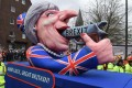 A carnival float depicting British Prime Minister Theresa May pointing a gun to her own head. Photo: AFP