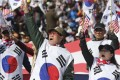 Supporters of former President Park Geun-hye shout slogans during a rally at downtown Seoul. Photo: AP