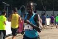 Menjo Jpsphat Kiprono during the ANS Shatin 10km Classic Riverside Race at Siu Lek Yuen. Photo: Richard Castka