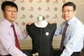 Professor Fei Bin (left) and Professor John Xin Haozhong(Xin is family name) with their protective vest. Photo: Xiaomei Chen