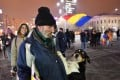 A man and his dog protesting in front of the government headquarters in Bucharest, against the controversial corruption decrees. Dogs were 'paid' to demonstrate against the government, according to one Romanian news report. Photo: AFP
