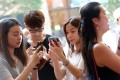 A recent survey of Hong Kong youngsters has found that more than 30 per cent are on their smartphones three to four hours per day. Photo: David Wong