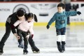 Children learn to skate in Hong Kong. As we mark Children's Day on April 4, we should reflect on whether we as a society are doing enough to ensure the well-being of our children. Photo: Xinhua