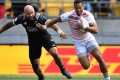England's Dan Norton shows New Zealand's DJ Forbes a clean pair of heels at the Wellington Sevens in January. Photo: AFP