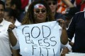 A Fijian rugby fan cheers for her favourite team during the Hong Kong Rugby Sevens tournament at Hong Kong Stadium. 30 March 2003