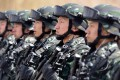 Chinese military police attend an anti-terrorist rally in Xinjiang, in one of China's attempts to combat what it views as a grave threat from extremists. Photo: AFP