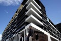 Sydney residents walk past a newly-completed apartment development in Sydney's inner-city suburb of Zetland. The country's banking watchdog is keeping a close eye on the country's red-hot housing market. Photo: Reuters