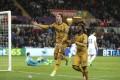 Tottenham Hotspur's Christian Eriksen celebrates scoring his side's third goal in the 3-1 win over Swansea. Photo: AP