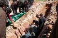 Syrians dig a grave to bury the bodies of victims of a toxic gas attack in Khan Sheikhun on Tuesday. Photo: AFP