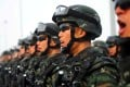 Paramilitary policemen taking part in an anti-terrorism rally in Kashgar in Xinjiang this February. Photo: Reuters