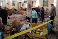 Security personnel investigate the scene of a bomb explosion inside Mar Girgis church in Tanta. Photo: EPA