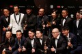 Actors, directors and producer of Trivisa pose after it won the best film and best director awards, among others, at the Hong Kong Film Awards in Hong Kong. Photo: Reuters