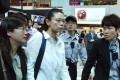 Li Ching-yu (centre), the wife of Taiwanese human rights activist Li Ming-che, at the airport in Taiwan. Photo: CNA