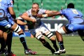 Irne Herbst of the Southern Kings (centre) in action against the Western Force. Photo: EPA