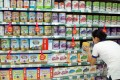 Shopping for baby formula at a supermarket in Haikou, Hainan province. The smuggling ring was allegedly sourcing milk powder from Hong Kong. Photo: AFP