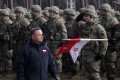 Polish President Andrzej Duda (C) attends a welcome ceremony for the North Atlantic Treaty Organization (NATO) Enhanced Forward Presence (eFP) contingent in the Military Training Centre of the Land Forces in Orzysz, Poland. The contingent will be stationed in Orzysz to reinforce NATO's eastern flank. Photo: EPA