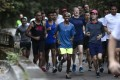 Mo Farah at the early-morning run on Bowen Road organised by Credit Suisse. Picture: Jonathan Wong