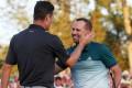 Justin Rose (left) congratulates Sergio Garcia. Photo: AFP