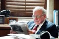 Warren Buffett at his desk in a documentary. His Berkshire Hathaway HomeServices entered into a marketing agreement with Juwai.com, China's largest international property website. Photo: HBO