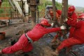 Labourers work at a well head in a PetroChina oil field in Tongnan, southwest China's Sichuan province. China National Petroleum Corp (CNPC) will be naming a new global trading arm chief to take the place of the veteran Wang Lihua, who is retiring shortly. Photo: Reuters