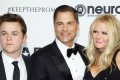 Actor Rob Lowe (C) wife Sheryl Berkoff (R) and their son John Owen Lowe (L) pose at Elton John's 70th Birthday. The former actor on West Wing and Brat Packer is now the new Colonel on Kentucky Fried Chicken. (KFC). Photo: Reuters