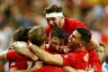 Canada players celebrate their victory in Singapore. Photo: Reuters