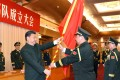 Communist Party general secretary Xi Jinping hands a military flag to the head of the PLA's ground forces, General Li Zuocheng, last year. Xinhua